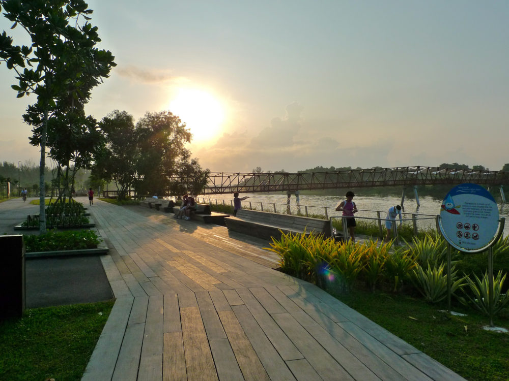 Riverside Walk's sunrise and the railway-like Lorong Halus Bridge in the distance. Photo by Eric Tee, Flickr Commons