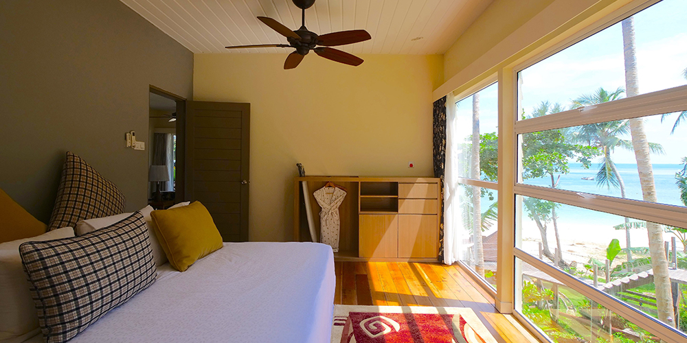 Sutera-Sanctuary-Bedroom-Interior-and-window-with-beach