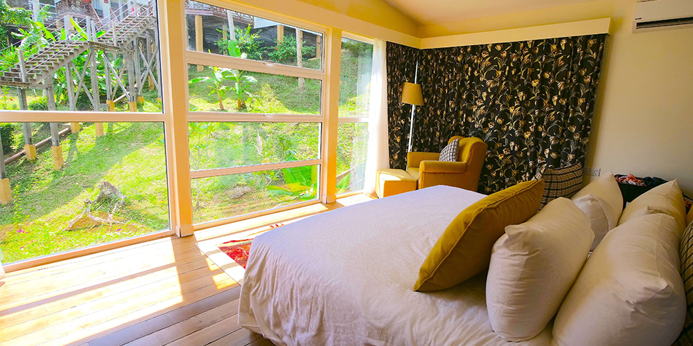 Sutera-Sanctuary-Bedroom-Interior-and-window-with-garden